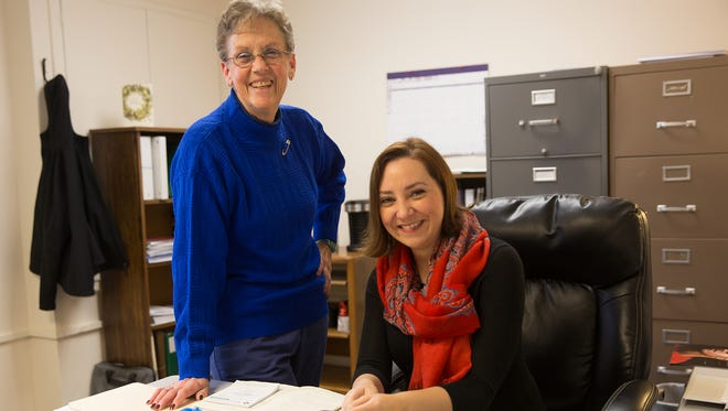 At left, Sara Kaynor, outgoing executive director of ECHO Inc., stands for a portrait beside the organization's new director, Alicia Borrego Pierce, on Thursday at the organization's administrative office in Farmington.