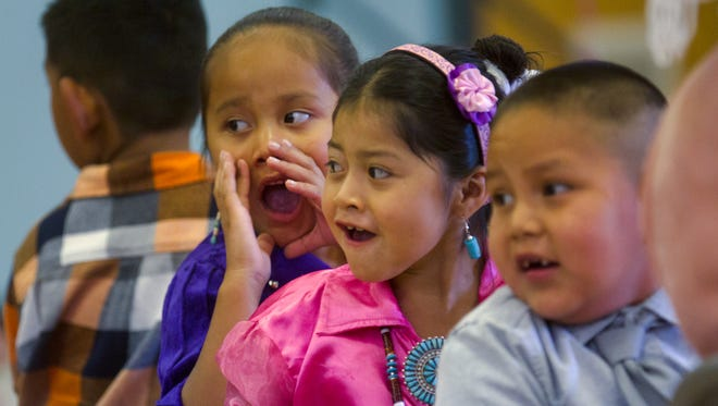 Camille Atene, left, and Makayla Peshlakai participate in a Dream DinéCharter School awards ceremony Friday during a year end-program at the Shiprock Chapter House.