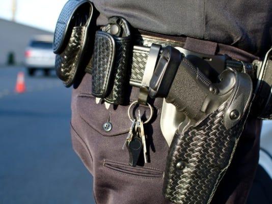 cop gun John Roman istock.jpg