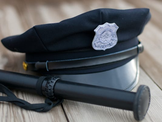 police hat and baton