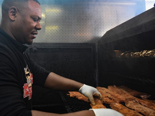 Manager Steve Fountain of The Smoke 'N Pig BBQ loads