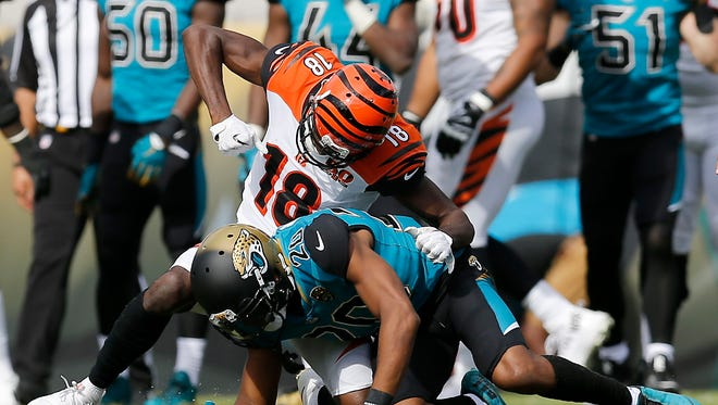 Cincinnati Bengals wide receiver A.J. Green (18) pulls back to throw a second punch to the helmet of Jacksonville Jaguars cornerback Jalen Ramsey (20) after a play late in the second quarter of the NFL Week 9 game between the Jacksonville Jaguars and the Cincinnati Bengals at EverBank Field in Jacksonville, Fla., on Sunday, Nov. 5, 2017. At halftime the Bengals trailed 10-7 after wide receiver A.J. Green was ejected for throwing a punch.