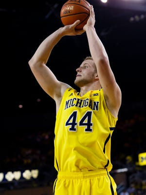 Michigan Wolverines forward Max Bielfeldt (44) shoots in the first half against the Rutgers Scarlet Knights at Crisler Center in Ann Arbor, Mich., on March 7, 2015.