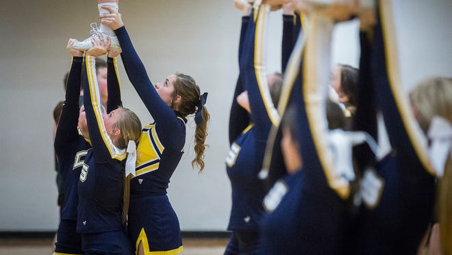 Delta High School cheerleaders during the Delaware County Basketball Tournament finals at Delta High School Saturday, Jan. 17, 2016. Earlier this year, the team asked the school board to allow them to continue wearing their short, uniform skirts during the school day, despite the dress code.