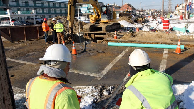 Workers install sewer lines along Grand Central Avenue at Princeton Avenue in Lavallette in January 2014 as part of the Route 35 reconstruction project.