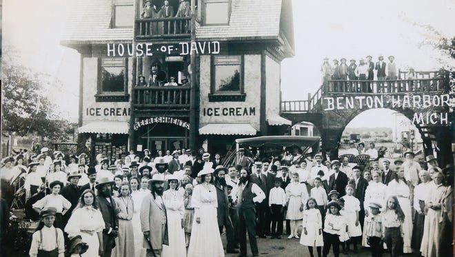 House of David founder Benjamin Purnell is seen standing with his followers outside of the House of David ice cream shop in Benton Harbor in a photo on display at the House of David Museum in St. Joseph.