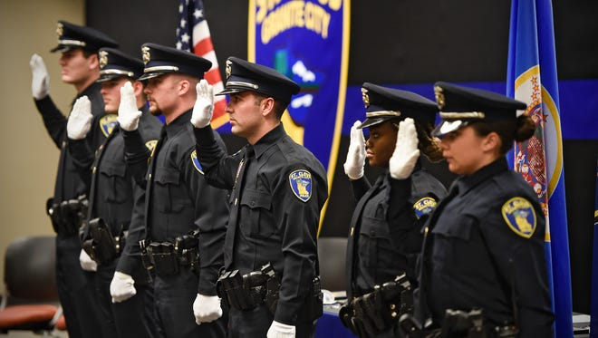 Six new officers take the oath  by St. Cloud mayor Dave Kleis during a graduation and swearing-in ceremony Thursday, Dec. 15, at the St. Cloud Police Department.