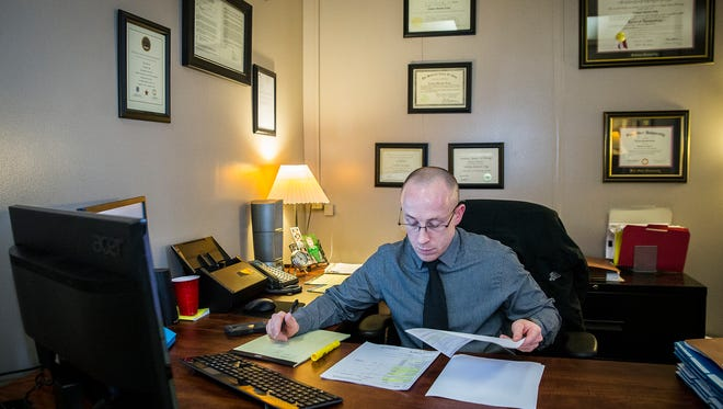 Chief Deputy Prosecutor Zach Craig in his new office at the Delaware County Building Wednesday afternoon.