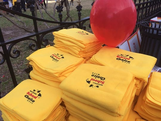 Organizers made yellow scarves available to participants at the school choice rally Tuesday at the Texas Capitol.
