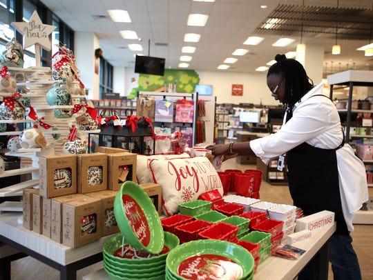 Store associate Paula Jones arranges a display in LifeWay
