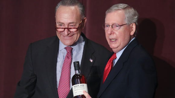 Sen. Chuck Schumer, left, presented Sen. Mitch McConnell
