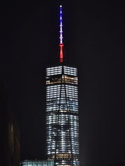 Red, white and blue colors are seen on top of the tower