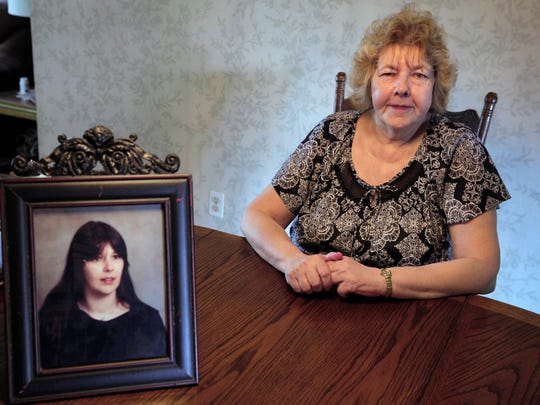 """Deborah Rothenburgh sits by a photo of her sister Evelyn Kretchman  when she was in her 20s. """"All of a sudden she just went away,"""" Rothenburgh said of her sister, who left her family in 1995."""