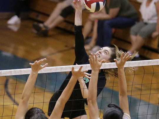 Montwood's Nadia Kern hits into Burges blockers Deandra