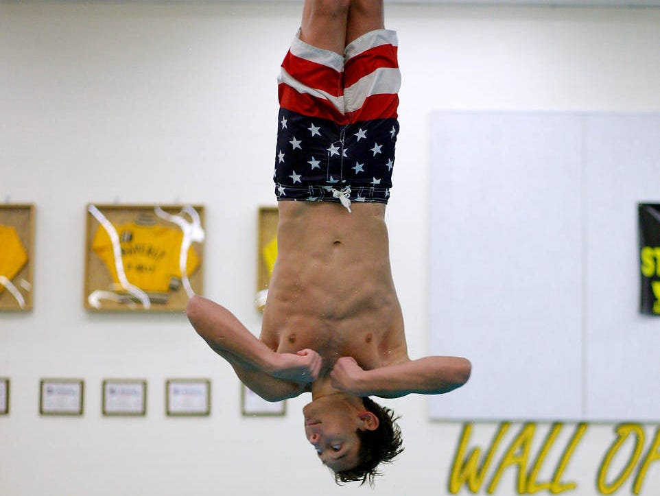 A Mason diver competes in the Waverly Relays Wednesday, Dec. 7, 2016, at Waverly High School.
