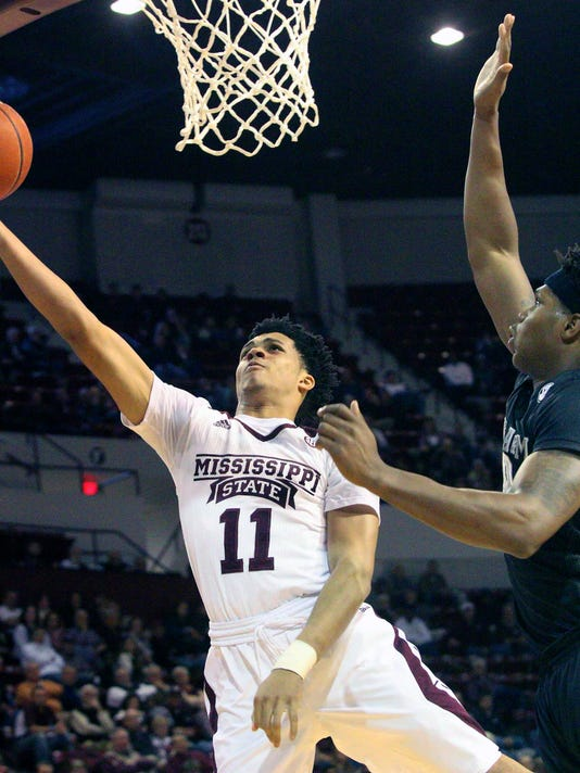 Mississippi State guard Quinndary Weatherspoon (11) shoots a layup as Texas A&M forward Tavario Miller (42) defends during the first half of an NCAA college basketball game in Starkville, Miss., Wednesday, Jan. 6, 2016. (AP Photo/Jim Lytle)