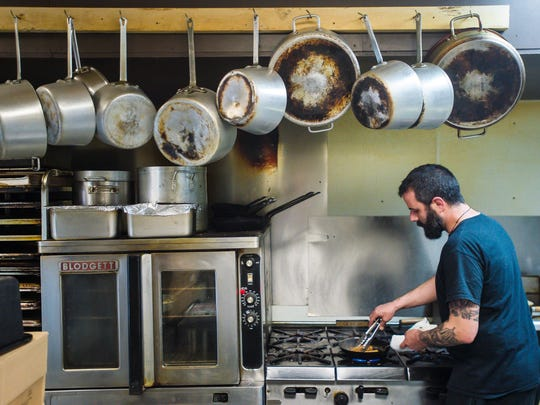 Chef Sam D'Avignon prepares a dish at The Mad Taco