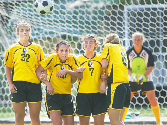 From left, Red Lion's Sam Faller, Tori Sprenkle, Monica Posey and Allison McKenzie attempt to block a penalty kick during a game against Central on Saturday. (DAILY RECORD/SUNDAY NEWS -- JASON PLOTKIN)