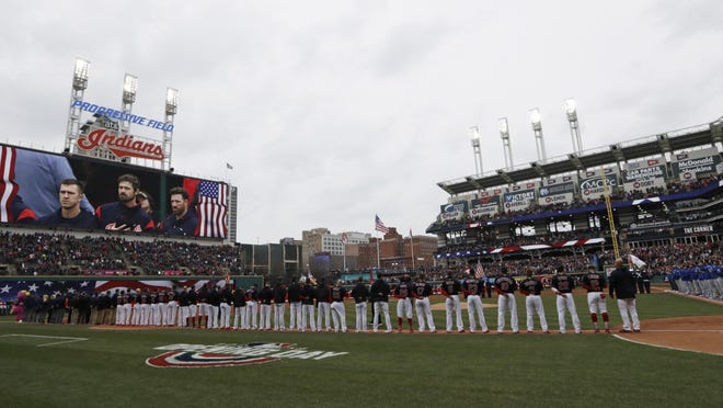 The Indians stand for the national anthem before the 2018 opener at Progressive Field in Cleveland.