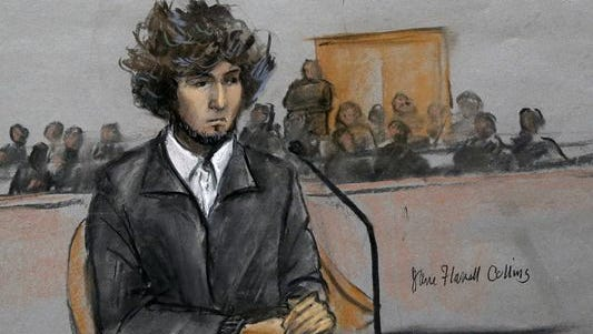 In this courtroom sketch, Boston Marathon bombing suspect Dzhokhar Tsarnaev is depicted sitting in federal court in Boston on Thursday, Dec. 18, 2014, for a final hearing before his trial begins in January. Tsarnaev is charged with the April 2013 attack that killed three people and injured more than 260.