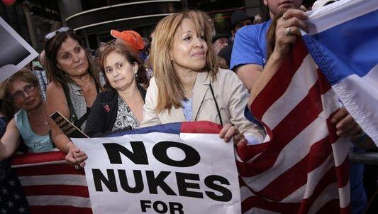 Protesters in New York on July 22 demand that Congress vote down the proposed deal with Iran.