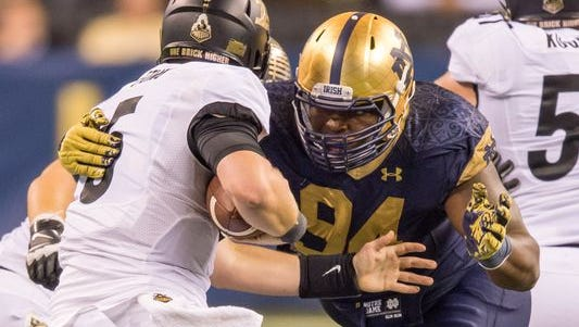 Notre Dame defensive lineman Jarron Jones is out for the season with a torn MCL.