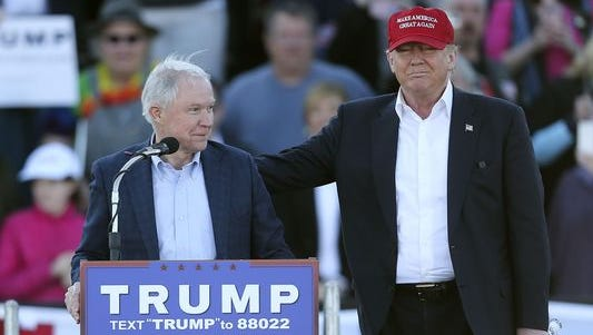 Donald Trump stands next to Sen. Jeff Sessions, R-Ala., as Sessions speaks during a rally on Feb. 28, 2016, in Madison, Ala.