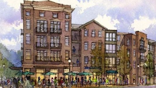 A rendering of proposed new apartments in Phoenix Hill shows the scene along Baxter Avenue at the intersection with Broadway.