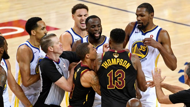 Tristan Thompson and Draymond Green argue during overtime in Game 1.