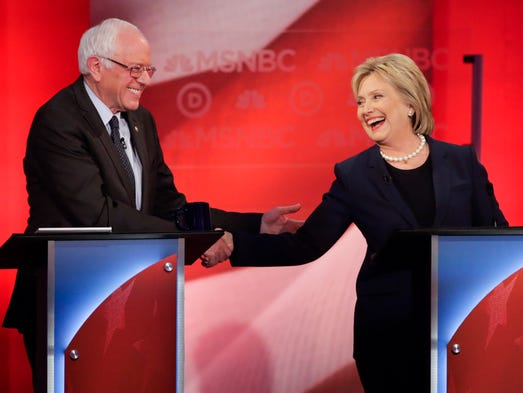 Sen. Bernie Sanders  and Hillary Clinton shake hands