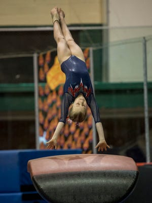 All American Flames' Brooke Schumacher, 11, competes in the vault during the WildFire Challenge gymnastics competition Saturday, Feb. 27, 2016 at McMorran Arena.