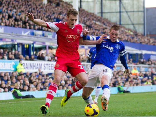 """FILE - This is a Sunday Dec. 29, 2013 file photo of  Southampton's Calum Chambers as he fights for the ball against Everton's James McCarthy,during their English Premier League soccer match at Goodison Park Stadium, Liverpool, England. English Premier League team Arsenal has signed defender Calum Chambers from Southampton for an undisclosed fee . The 19-year-old Chambers has penned a """"long-term"""" contract at Arsenal, according to the North London club on Monday July 28, 2014. (AP Photo/Jon Super, File)"""