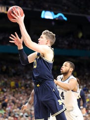 Michigan forward Moritz Wagner drives to the basket