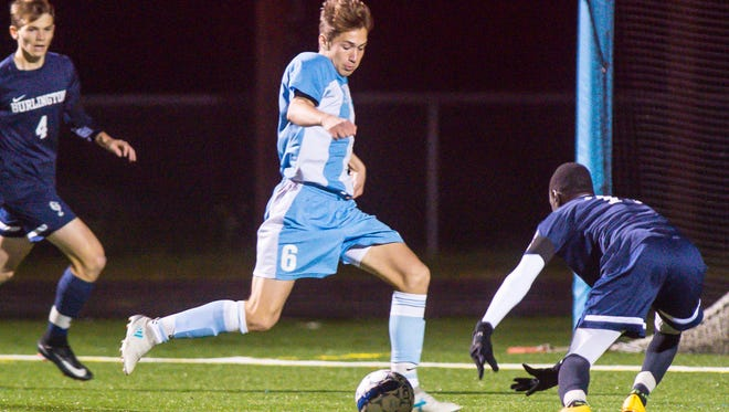 South Burlington's Josh Coon shoots and scores against Burlington in South Burlington on Wednesday, October 18, 2017.