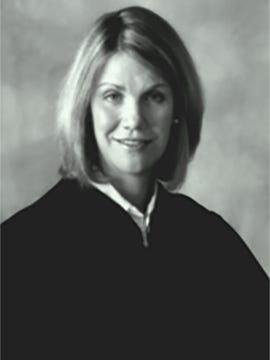 Texas District Court Judge Julie Kocurek, shot and wounded outside her home in Austin late Friday