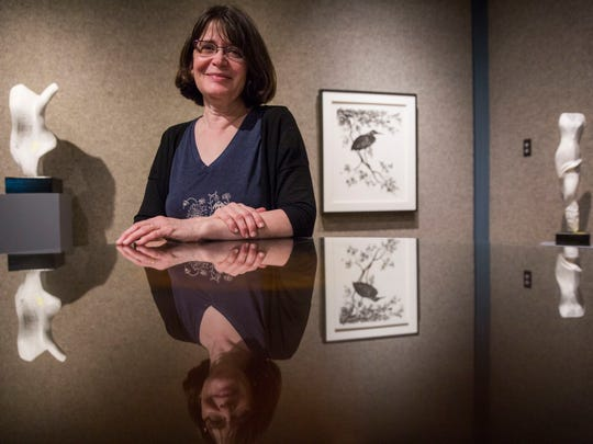 """Lucrezia Bieler, an artist being featured as the """"scissor"""" aspect in the Marco Island Center for the Arts Rock Paper Scissors Exhibition poses for a portrait in the gallery on Friday, May 4, 2018."""