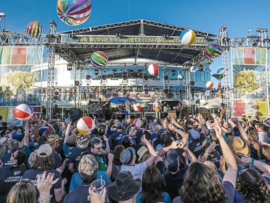 Music fans toss beach balls during the Rock Boat Cruise.