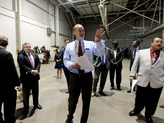 Onno Steger speaks to officials on a tour of the empty General Motors facility in Shreveport.