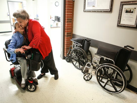 Viola Hall, 80, left, receives a hug from Eula Hall,