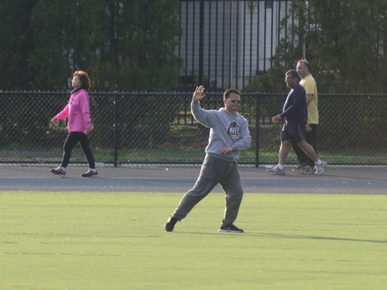 A man does Tai Chi at Tryon Field in Rutherford Monday