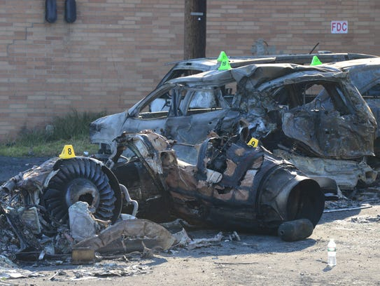 Charred cars in Carlstadt on Wednesday, two days after