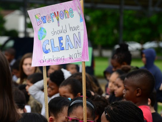 Students marched and carried signs to Tuesday's inauguration