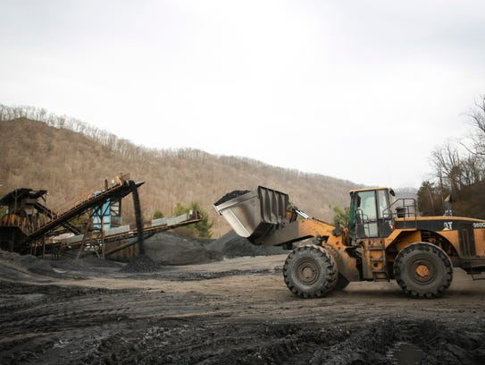 A front loader moves coal in Prestonsburg, Ky.