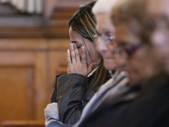 Luz Rodriguez of Hackensack prays at the First Presbyterian