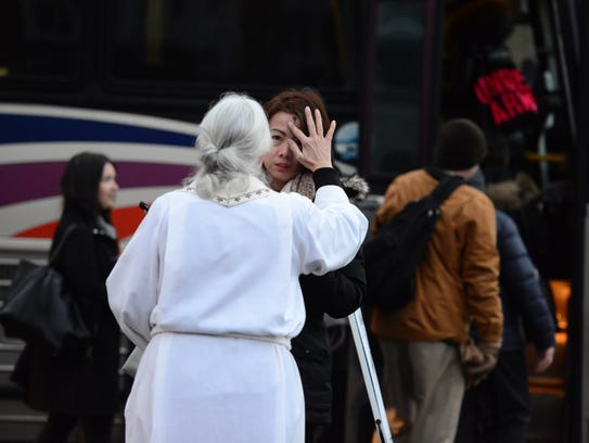 Kerr imposes ashes on Ash Wednesday to a commuter,
