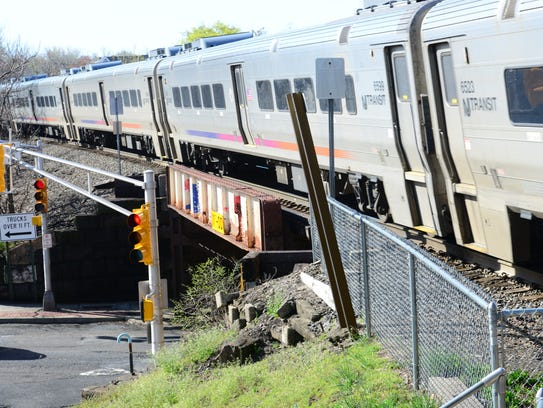 An NJ Transit train approaches the Garfield Train Station