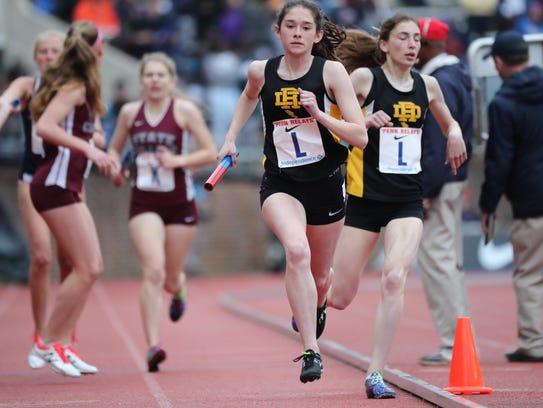 Eve Schoenberg, of River Dell, runs the anchor leg