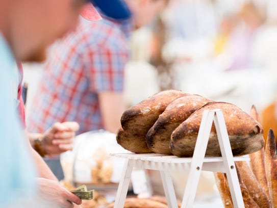 Loaves of bread are for sale at the opening day of the 2018 Market Square Farmers Market in Knoxville on May 2.