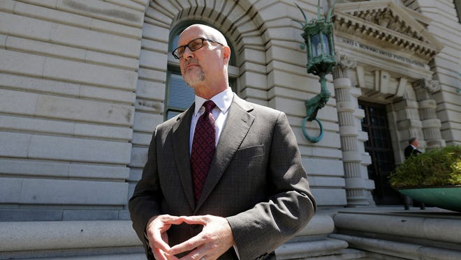 Jeffrey Kerr, general counsel to the People for the Ethical Treatment of Animals, speaks to reporters outside of the 9th U.S. Circuit Court of Appeals in San Francisco on Wednesday. Attorneys for David Slater, a wildlife photographer whose camera was used by a monkey to snap selfies, asked a federal appeals court to end a lawsuit seeking to give the animal rights to the photos.
