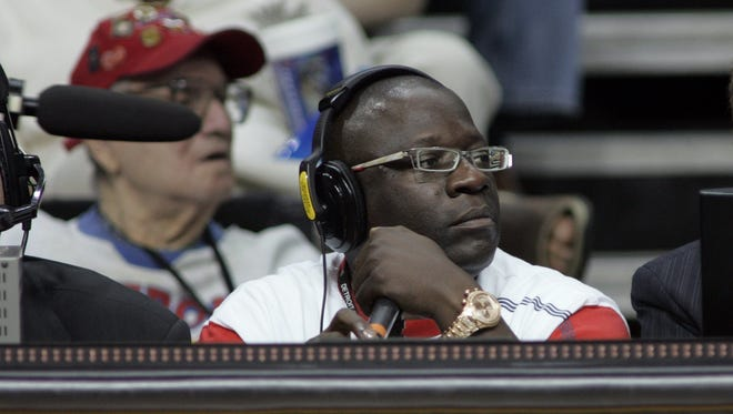 Detroit Pistons PA announcer John Mason watches a game May 9, 2005.